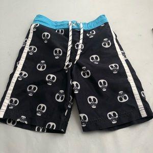 Children's Place black/white skull swim trunks 7/8